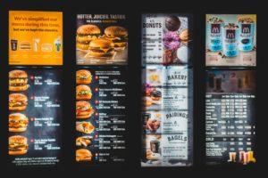 A mcDonald's menu board. Photo by Erik Mclean on Unsplash